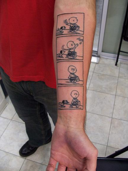 Jeff sent us this picture of his wife Heather's Snoopy tattoo (her first,